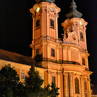 Minorite Church in Dob&oacute; Square at Night in Eger, Hungary <br /> The Minorite Order of monks arrived in Eger during the 13th century. Their first church survived until the 18th century despite witnessing several invasions. The current structure with twin bell towers was designed by Kilian Ignaz Dientzenhofer and dedicated in 1771 to Saint Anthony of Padua. He was a 13th century friar and the patron saint of lost souls, people and objects. This superb example of Baroque architecture &ndash; one of the finest in Europe - graces Dob&oacute; Square.