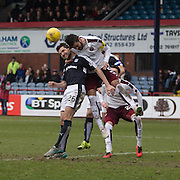 Hearts&rsquo; Alim Ozturk heads clear from Dundee&rsquo;s Kostadin Gadzhalov  - Dundee v Hearts - Ladbrokes Premiership at Dens Park <br />  - &copy; David Young - www.davidyoungphoto.co.uk - email: davidyoungphoto@gmail.com