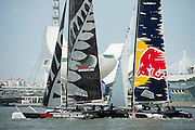 Emirates Team New Zealand and Red Bull Racing, race 13 on day two of the Extreme Sailing Series regatta being sailed in Singapore. 21/2/2014