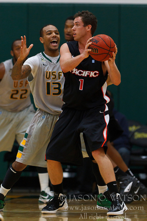 Dec 10, 2011; San Francisco CA, USA;  Pacific Tigers forward Trevin Harris (1) is defended by San Francisco Dons guard Rashad Green (13) during the first half at War Memorial Gym.  Mandatory Credit: Jason O. Watson-US PRESSWIRE