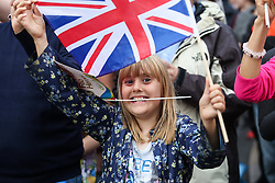 © Licensed to London News Pictures. 28/09/2016. Leeds, UK. A girl waves a flag during the Olympic and Paralympic parade in Leeds. Yorkshire's Olympic and Paralympic stars receive a heroes' welcome during an open top bus parade in Leeds, West Yorkshire. . Photo credit : Ian Hinchliffe/LNP