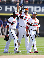 CHICAGO - AUGUST 25:  Alejandro De Aza #30 (L), Leury Garcia #28 and Jordan Danks #20 of the Chicago White Sox celebrate after the game against  the Texas Rangers on August 25, 2013 at U.S. Cellular Field in Chicago, Illinois.  The White Sox defeated the Rangers 5-2.  (Photo by Ron Vesely)   Subject:    Alejandro De Aza; Leury Garcia; Jordan Danks