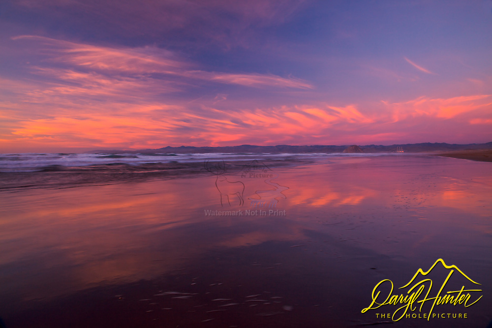 Sunset, reflection Morro Bay, California
