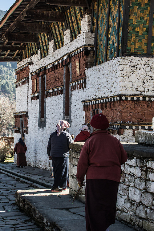Morning prayers is a way of life. Buddhist devotees in Bhumtang, Bhutan.