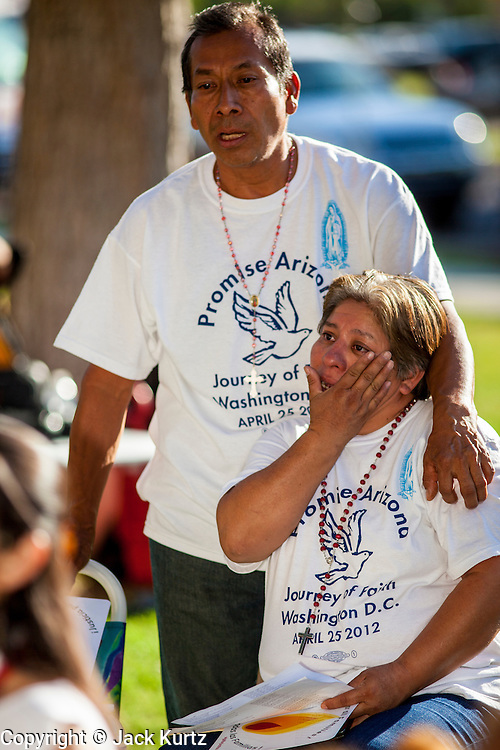 21 JUNE 2012 - PHOENIX, AZ:   GUSTAVO CRUZ, left, comforts PATRICIA ROSAS, while they wait for the US v. Arizona decision in front of the Arizona State Capitol Thursday. About 40 people, members of the immigrant rights' group Promise AZ (PAZ), gathered at the Capitol in Phoenix to wait for the US Supreme Court decision on SB 1070, Arizona's controversial anti-immigrant law, in the case US v. Arizona. The court's ruling is expected sometime later this month. Members of PAZ said they would continue their vigil until the ruling was issued.       PHOTO BY JACK KURTZ