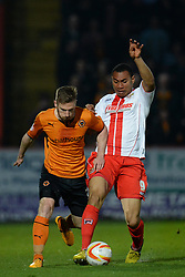 Wolves midfielder Michael Jacobs  and Stevenage's defender Darius Charles  compete for the ball  - Photo mandatory by-line: Mitchell Gunn/JMP - Tel: Mobile: 07966 386802 01/04/2014 - SPORT - FOOTBALL - Broadhall Way - Stevenage - Stevenage v Wolverhampton Wanderers - League One