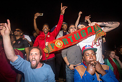 © Licensed to London News Pictures. 10/07/2016. London, UK. Portugal fans celebrate in Kennington, London, after beating France 1-0 in extra time at the UEFA Euro 2016 Final. Photo credit : Tom Nicholson/LNP