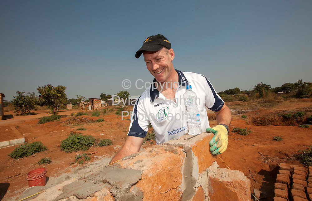 9/6/2012.no charge for repro..Rugby great Paddy Johns house building and pictured as part of the  Brent Pope Rugby Legends Tour  of Zambia in partnership with Habitat for Humanity Ireland..Picture Dylan Vaughan..