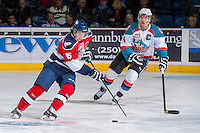 KELOWNA, CANADA -FEBRUARY 19: Madison Bowey #4 of the Kelowna Rockets checks Rodney Southam #15 of the Tri City Americans as he skates with the puck during third period on February 19, 2014 at Prospera Place in Kelowna, British Columbia, Canada.   (Photo by Marissa Baecker/Getty Images)  *** Local Caption *** Madison Bowey; Rodney Southam;