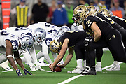 The New Orleans Saints offensive line gets set to snap the ball at the line of scrimmage opposite the Dallas Cowboys defensive line during the NFL week 13 regular season football game against the Dallas Cowboys on Thursday, Nov. 29, 2018 in Arlington, Tex. The Cowboys won the game 13-10. (©Paul Anthony Spinelli)