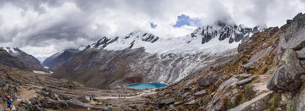 Day 2 of 10: From Punta Union (a pass at 15,584 feet or 4750 m), see Nevado Rinrijirca (5810 m) above Lago Taullicocha. Trek 10 days around Alpamayo, in Huascaran National Park (UNESCO World Heritage Site), Cordillera Blanca, Andes Mountains, Peru, South America. This panorama was stitched from 11 overlapping photos.