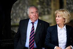© Licensed to London News Pictures. 18/04/2016. Shirley, UK.  Jimmy Tarbuck and wife Pauline Tarbuck leave The funeral of comedian, actor, writer Ronnie Corbett, held at St John the Evangelist Church in Shirley near Croydon. Corbett, who was most famous for his comedy sketch show  The Two Ronnies, performed with the late Ronnie Barker, died at the age of 85. Photo credit: Ben Cawthra/LNP