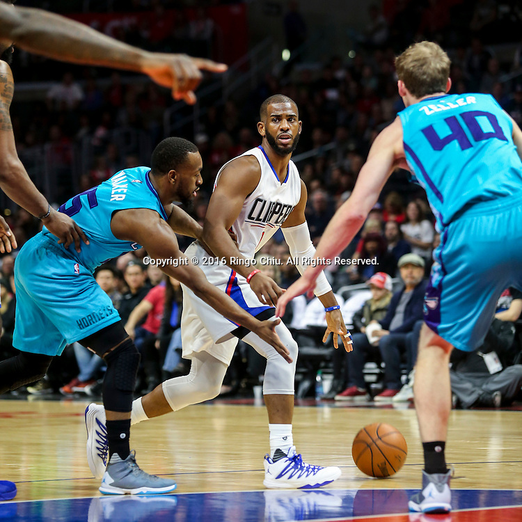 Los Angeles Clippers Chris Paul dibbles against Charlotte Hornets during the NBA basketball game in Los Angeles, the United States, Jan. 9, 2016. Los Angeles Clippers won 97-83. (Xinhua/Zhao Hanrong)(Photo by Ringo Chiu/PHOTOFORMULA.com)<br /> <br /> Usage Notes: This content is intended for editorial use only. For other uses, additional clearances may be required.