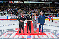 KELOWNA, CANADA - NOVEMBER 9: Military officials, Mayor Colin Basran and Kelowna Rockets GM Bruce Hamilton line up for the ceremonial puck drop between Team WHL and Team Russia on November 9, 2015 during game 1 of the Canada Russia Super Series at Prospera Place in Kelowna, British Columbia, Canada.  (Photo by Marissa Baecker/Western Hockey League)  *** Local Caption *** Mayor Colin Basran; Bruce Hamilton;