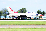 A US Air Force Thunderbirds F-16 begins its takeoff roll at Whitman Airport in Oshkosh, Wisconsin.
