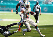 Sep 23, 2018; Miami Gardens, FL, USA; Miami Dolphins wide receiver Albert Wilson (15) tries to get loose and run after a catch while Oakland Raiders cornerback Gareon Conley (21) attempts to tackle him at Hard Rock Stadium. The Dolphins defeated the Raiders 28-20. (Steve Jacobson/Image of Sport)