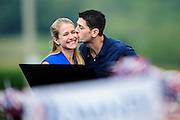 Republican Vice Presidential Candidate Rep. Paul Ryan kisses his wife Janna before speaking to supporters at the Rockingham County Fairgrounds near Harrisonburg, Virginia on Friday.