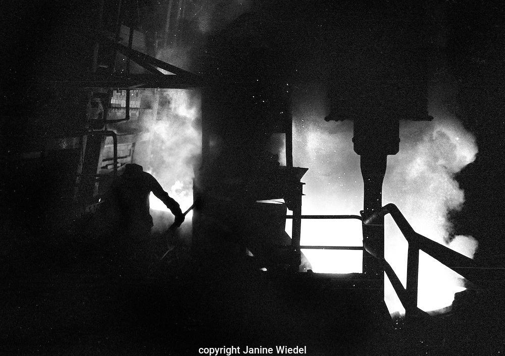 Open Hearth Furnace during tapping.During this process the steel was collected in a ladle and other materials could be added directly to it to bring the steel to it's correct composition.<br />
