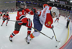 Feb 11; Newark, NJ, USA; New Jersey Devils right wing Dainius Zubrus (8) hits Florida Panthers center Mike Santorelli (13) during the first period at the Prudential Center.