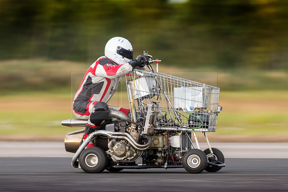 © Licensed to London News Pictures. 15/09/2018. York UK. Matt McKeown hits 91.5mph today on the worlds fastest shopping trolley at the Straight Liners speed event held at Elvington Airfield near York. The trolley is powered by a jet engine from a Chinook helicopter that Matt bought on Ebay. Photo credit: Andrew McCaren/LNP