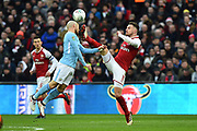 David Silva (21) of Manchester City is kicked in the face while challenging Aaron Ramsey (8) of Arsenal during the EFL Cup Final match between Arsenal and Manchester City at Wembley Stadium, London, England on 25 February 2018. Picture by Graham Hunt.