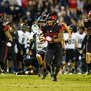 24 November 2018: San Diego State Aztecs running back Juwan Washington (29) scores on the Aztecs firsts play in overtime on a 25 yard run to bring the Aztecs within one of tying the game. The Aztecs closed out the season with a 31-30 overtime loss to Hawaii at SDCCU Stadium.