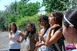 USA, Chicago, August 25, 2009.  Daniela Jurado, Jasmine Becerra, and Viviana Galvan listen to Amairani Galvan explain a waste-processing plant's harmful effects. The Little Village Environmental Justice Organization, headquartered in a predominantly Mexican-American neighborhood of Chicago, campaigns not only against pollution but for clean power, park facilities, urban agriculture, and restoring public transit. LVEJO's staff and volunteers make significant outreach and education efforts, especially for youth. Photo for an HOY feature story by Jay Dunn.