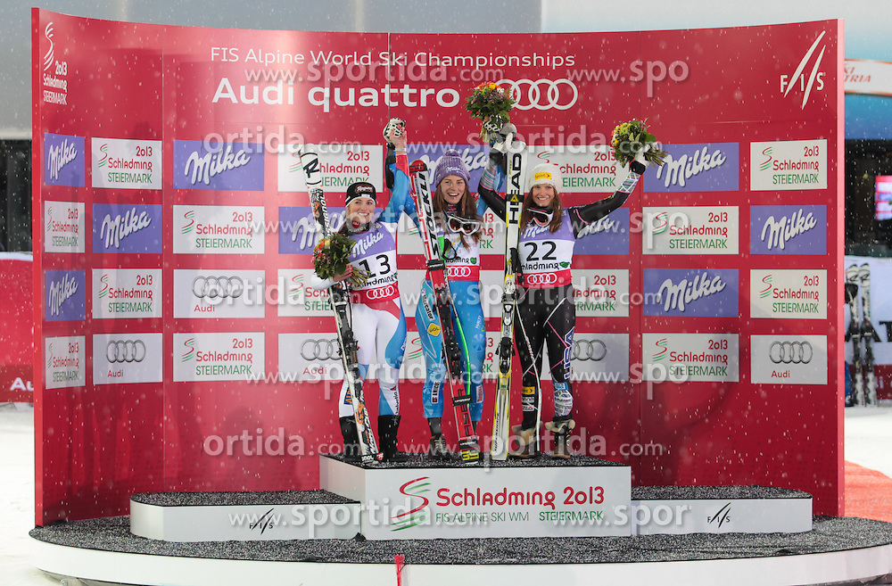 05.02.2013, Planai, Schladming, AUT, FIS Weltmeisterschaften Ski Alpin, Suber G, Damen, Siegerpraesentation, im Bild Lara Gut (SUI, 2. Platz), Tina Maze (SLO, 1. Platz), Julia Mancuso (USA, 3. Platz) // 2nd place Lara Gut of Switzerland, 1st place Tina Maze of Slovenia, 3th place Julia Mancuso of United States on Winners Presentation during ladies SuperG at the FIS Ski World Championships 2013 at the Planai Course, Schladming, Austria on 2013/02/05. EXPA Pictures © 2013, PhotoCredit: EXPA/ Sammy Minkoff
