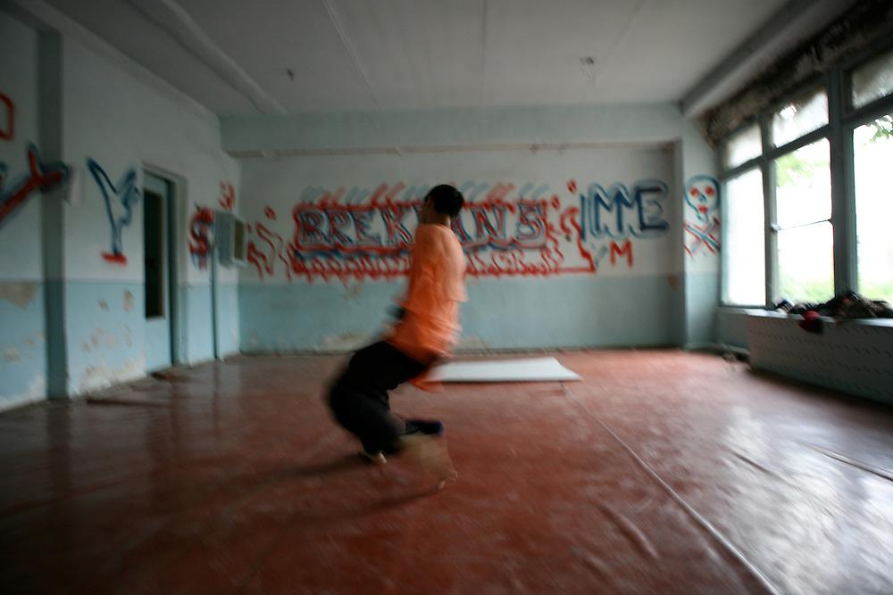 Lutfullo, 16, is break-dancing in Kokand