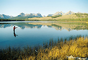 THIS PHOTO IS AVAILABLE FOR WEB DOWNLOAD ONLY. PLEASE CONTACT US FOR A LARGER PHOTO. Fly fishing on Little Redfish Lake Idaho.