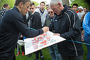 Phil Neville signs a Manchester United poster at the BMW PGA Championship Celebrity Pro-Am Challenge at the Wentworth Club, Virginia Water, United Kingdom on 20 May 2015