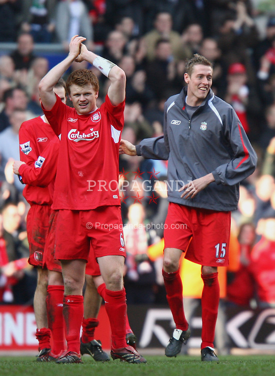 LIVERPOOL, ENGLAND - SATURDAY, FEBRUARY 18th, 2006: Liverpool's match-winner Peter Crouch celebrates his side's 1-0 victory over Manchester United with his team-mate John Arne Riise during the FA Cup 5th Round match at Anfield. (Pic by David Rawcliffe/Propaganda)