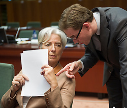 Christine Lagarde, France's finance minister, left, speaks with Jyrki Katainen, Finland's finance minister, during the emergency meeting of European Union finance ministers in Brussels, Belgium, on Sunday, May 9, 2010.  European Union finance ministers meet today to hammer out the details of an emergency fund to prevent a sovereign debt crisis from shattering confidence in the 11-year-old euro. (Photo © Jock Fistick)