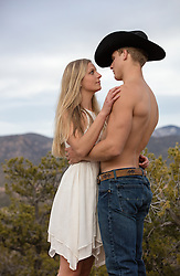 shirtless cowboy with a beautiful girl outdoors