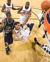 Virginia guard Mustapha Farrakhan (2) is fouled by Xavier guard Dante Jackson (25) while shooting a jump shot.  The #22 ranked Xavier Musketeers defeated the Virginia Cavaliers 84-70 at the John Paul Jones Arena on the Grounds of the University of Virginia in Charlottesville, VA on January 3, 2009.