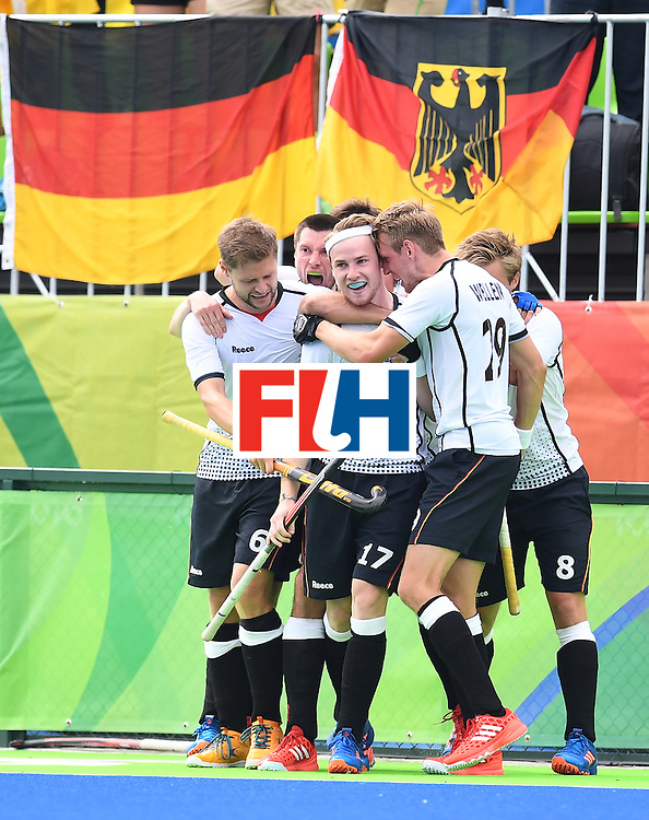 Germany's Christopher Ruhr(C) celebrates scoring a goal with teammates during the men's field hockey Germany vs India match of the Rio 2016 Olympics Games at the Olympic Hockey Centre in Rio de Janeiro on August, 8 2016. / AFP / MANAN VATSYAYANA        (Photo credit should read MANAN VATSYAYANA/AFP/Getty Images)