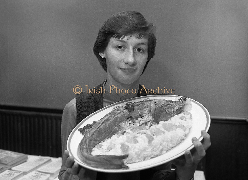 """""""The National Fish Cookery Award""""..29.04.1982..04.29.1982.29th April 1982.1982..This competition sponsored by Bord Iascaigh Mhara was held in The Clare Inn, Newmarket-on Fergus,Co Clare. the competition was open to schools across the country..The Competition winner,Catherine O'Sullivan,(15),Vocational School,Rathdowney,Laois poses  with her prize winning dish."""