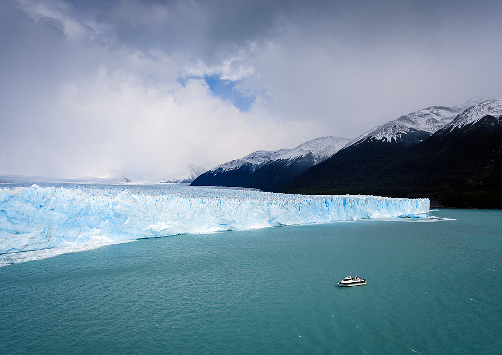 NATIONAL PARK LOS GLACIARES, ARGENTINA - CIRCA FEBRUARY 2019: Boat with tourists navigating the waters Argentino Lake on the Glacier Perito Moreno, a famous landmark within the Los Glaciares National Park in Argentina