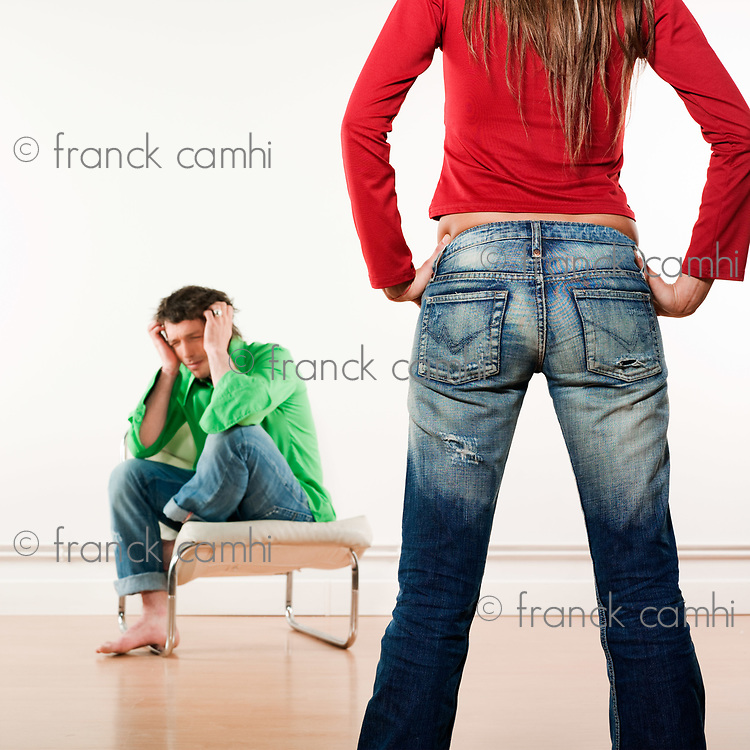 studio shot pictures on isolated background of a woman standing in front of a man