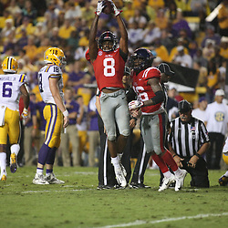 Sep 29, 2018; Baton Rouge, LA, USA; Mississippi Rebels defensive back C.J. Miller (8) celebrates after recovering a fumble against the LSU Tigers during the second quarter of a game at Tiger Stadium. Mandatory Credit: Derick E. Hingle-USA TODAY Sports