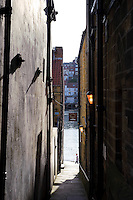 A narrow alleyway leading to Whitby harbour and F.A.R.C harbour bar