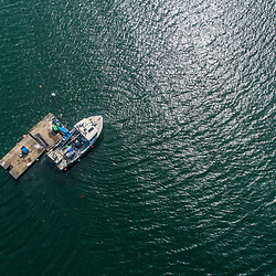 A lobster boat anchored off of Little Chebeague Island in Casco Bay, Portland, Maine.