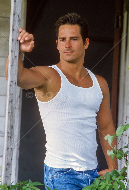 hot All American man in a tank top on a porch