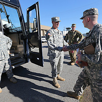 Gen. John Rhodes, center, sends off the troops from the 1-185th Aviation Regiment in Tupelo as they departed Sunday from their headquarters in Tupelo to begina 10 month deployment in Kosovo in support of Operation Joint Guardian.