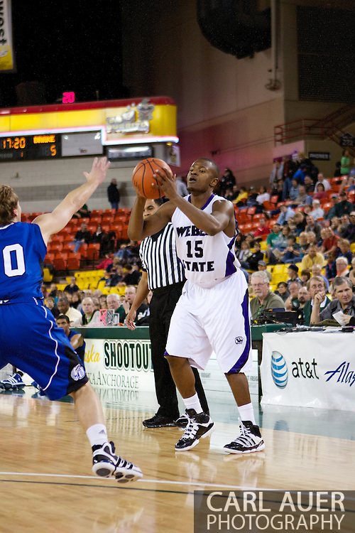 November 27th, 2010:  Anchorage, Alaska - Weber State senior guard Lindsey Hughey (15) looks for a pass in the Wildcat's 82-81 victory over the Drake Bulldogs in the third place game of the Great Alaska Shootout.