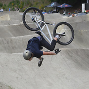 Connor Jaine, 15, from Timaru attempts a somersault during the Gorge Road Mega Jam, for BMX and Mountain Bike riders to mark the opening  of the Gorge Road Jump Park run by the Queenstown Mountain Bike Club,  Queenstown, New Zealand. 3rd December 2011. Photo Tim Clayton
