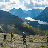 hikers hiking along scenic point trail, glacier national park