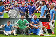 Manchester City win the Charity Shield and prepare for photographs after the FA Community Shield match between Manchester City and Liverpool at Wembley Stadium, London, England on 4 August 2019.