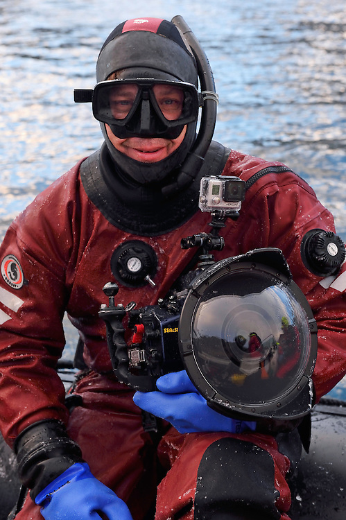 Underwater photographer Magnus Lundgren in his drysuit, ready to go swimming with whales, Senja, Troms county, Norway, Scandinavia