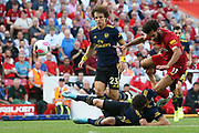 Liverpool forward Mohamed Salah (11) and Arsenal defender Sokratis Papastathopoulos (5) tangle as they go for the ball during the Premier League match between Liverpool and Arsenal at Anfield, Liverpool, England on 24 August 2019.
